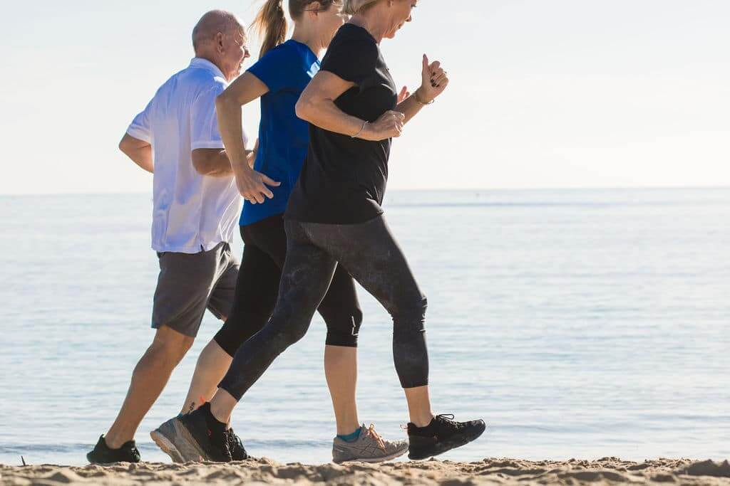 Running for Beginners : Beginners and Coach on Beach in Ibiza