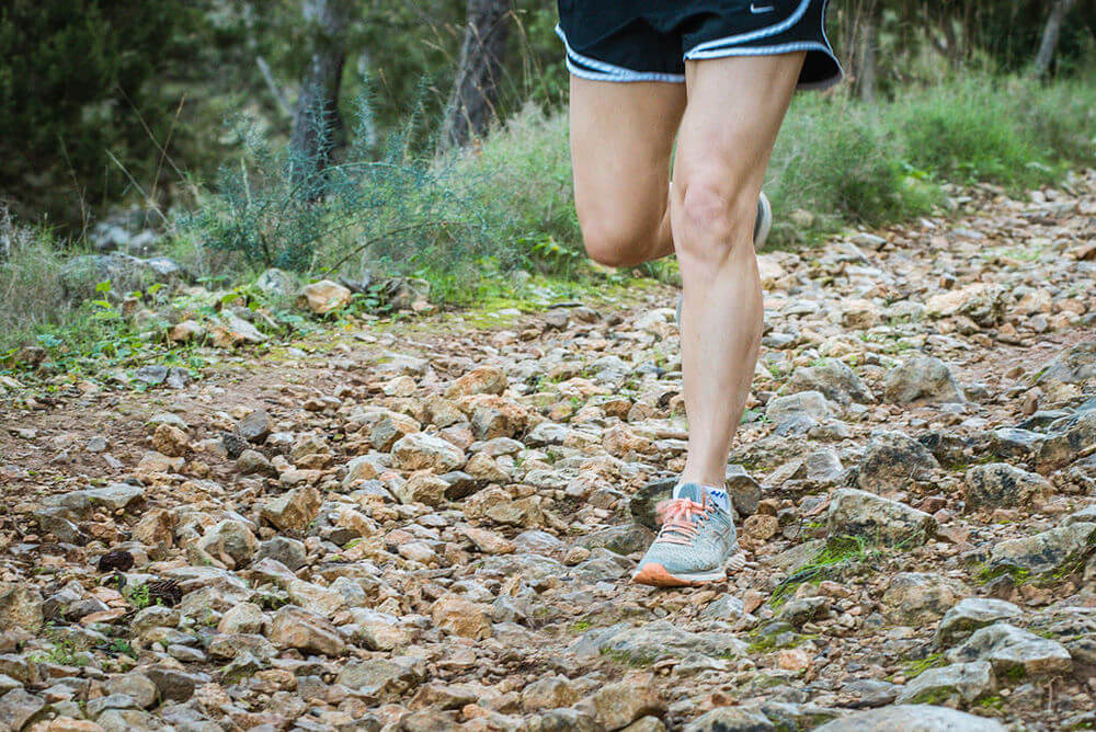 Runner's legs on a Trail in Ibiza